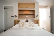 Alcove wall storage above bed.  Compact double bedroom