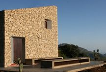 Weekend pavilion / Small house thought as a compact block, respecting the architecture of the area and the enviorment. The façade is built as the retaining walls of the agricultural lands in this area.