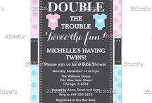 Double Trouble Twin Boy and Girl Baby Shower / This design features two baby outfits in blue and pink with a white heart in the center. The background is blue and pink polka dots and a gray chalkboard with a dotted border.