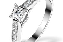 """Engagement Rings - Solitaire With Diamond Shoulders / The sidestones in a diamond ring are found on the ring's metal band, either side of the main stone. Also called a """"diamond shoulder ring"""", these styles are set with small side diamonds that add overall radiance to the ring and enhance the central stone. If you're searching for a sophisticated and fashionable engagement ring with big sparkle, one of our diamond shoulder rings made with high grade, conflict-free stones and UK hallmarked gold or platinum is the perfect choice..."""