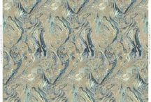 Upperlands Collection - Ripple / Sister design to Torrent, paper marbling on a smaller scale pays homage to the gentle rippling of the river Clady. Today it is hard to imagine how such a large operation was built upon the water supply from a humble tributary such as the Clady.