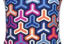 pink and blue pillows / by Chiara Milott