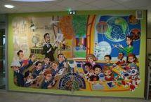 Ecole de Beauval - Fresques / De très jolies fresques murales ornent les murs de l'école du Valençon. Réalisées par l'artiste doullennais Joan VIFQUIN. Elles racontent aux enfants, par le biais de l'image, l'histoire de l'humanité.