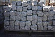 cobblestones / we are processors and exporters of  Cobblestones, Paving slabs, Landscaping products Balls, Benches, Bird baths, Building stones like window cills, quoins, coping stones steps,Poars, columns, Gate Posts, Pergolas etc