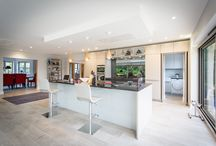 Pure Sophistication / This couple wanted to create a warm and homely open-plan kitchen living space taking full advantage of the panoramic views that flank their home.They desired touches of elegance that would enhance specific areas and bring individuality and life.