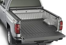 Roll Up Truck Bed Cover / The custom-fit Roll Up Truck Bed Cover is made from a double-coated commercial grade reinforced vinyl and features a heavy duty water resistant design that protects cargo from tough weather. It also includes a dual locking system that provides excellent security, designed to help reduce aerodynamic drag and increase gas mileage, making it the perfect addition to your pickup truck.