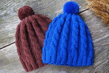 Blue knitted clothes hats mittens cardigans shawls