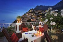 Positano, Amalfi Coast, Italy. / The distinguished Le Sirenuse, a luxury boutique hotel in Positano, Amalfi Coast, Italy.  Every room has its little balcony and looks over the blue sea to the islands of the sirens from which those ladies sang so sweetly.