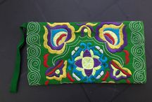 Boho Hippy Gipsy clutches with embroidery . Euro 10,00 / Boho clutch 5     All these boho clutches are handmade in exotic faraway lands and specially selected for you! These clutches have a zipper and two pockets distribution and have a handy wrist strap on the inside. These bags are completely embroidered in bright colors!  These bags are very nice for festivals, makeup, or evening bag while walking! Your phone and keys fit with ease!  Dimensions 22 x 12 cm