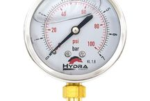 Pressure Gauges & Adapters / Hydra-Part pressure gauges are designed and built by one of the largest gauge manufactures worldwide! We hold stock of both 63mm pressure gauges and 100mm pressure gauges. Our range covers from 7 Bar to 600 BAR in both panel and stem mount options.