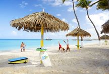 "Aruba / With a slogan like ""One Happy Island"", it's no surprise Aruba is one of the most visited (and revisited!) islands in the Caribbean.  Perfect for couples and honeymooners embarking on life's great adventure together, Aruba offers visitors consistently sunny weather, low humidly, colorful marine life, a lively nightlife, and a multinational cuisine. http://goo.gl/aTL2R5"