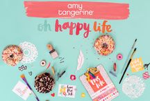 Amy Tangerine Oh Happy Life / Have good times and fun adventures with Oh Happy Life by Amy Tangerine. Preserve travel memories or everyday moments with this colorful collection! Delightful icons of doughnuts, animals, cameras and cars are presented in a true rainbow of colors. Tell your story and let the good times roll with Oh Happy Life!