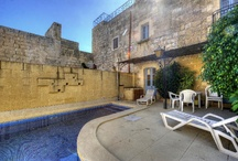 FARMHOUSES AND HOUSES OF CHARACTER + POOL - GOZO and Houses of Character With Pools Gozo /     Sannat - Gozo     € 280,000     3 Double Bed Converted Farmhouse + Pool     Ref: 106375  Charming converted FARMHOUSE comprising entrance through large courtyard with pool, entrance hall, combined kitchen/dining room, sitting room opening onto a back yard/garden, three double bedrooms, three baths/showers and roof terrace. Full of traditional features and old character. Very good restoration. Being sold fully furnished, equipped and ready to move into. Included in price. Furnished