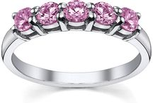 October Birthstone Jewelry / Our pink sapphire gemstones are natural and of the highest AAA quality.  We offer a large variety of pink sapphire jewelry, including eternity rings, five stone rings, and pink sapphire station necklaces.  Let us help you pick out the perfect birthday gift for the one that you love.