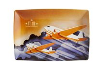 Transcontinental | Vista Alegre / The spirit of adventure and confidence in progress are dominant feelings in the golden period of Art Deco. The iconography of the time is filled with representations of speed and mechanical ingenuity, of human and technological prowess - a visual and ideological universe that this collection brings back to us.