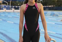 Girls Racing Kneesuit / New designed swimwear for girls!  FINA approved racing fabric.  Suits all body shapes.  Designed to increase performance in the water.