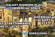 Galaxy Diamond Plaza Noida / Galaxy Diamond Plaza brought a luxury commercial spaces for property seekers. The benchmark commercial project has been located in Noida Extension at huge area. It is providing office spaces, retail shops with all luxurious comforts, the project has set a paradigm.
