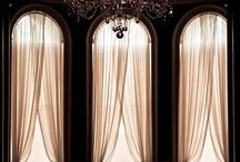 Tall windows with pretty drapery