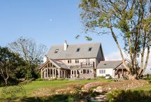 Oak Frame Houses / A selection of Cornish timber frame houses, produced by Carpenter Oak Cornwall. Traditional and contemporary designs, all handcrafted.