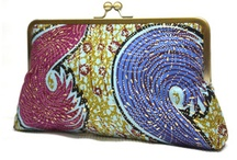Clutch Purses: The Snap Clutch Collection / The medium-sized handmade kiss lock clutch in bold batiks and print fabrics.