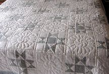 grey and white quilts