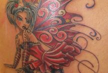 Tattoos and piercings / by Ashley Olson