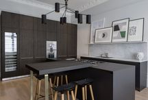 Kitchen Architecture bultha case Study : Bespoke bulthaup in north west London apartment / Bespoke bulthaup in north west London apartment. Kitchen Architecture - bulthaup b3 range with base units in graphite with Carrera marble worktop and brass recess handles and legs; tall unit and bar in black brown oak. Interior designer: Roselind Wilson