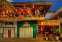 Tiki Tok Restaurant Bar / Kick off your shoes, feel the sand between your toes, and enjoy a beautiful sunset with one of our original tropical drinks. Stick around for live salsa music and some homestyle cooking. Visit us and let your inner tiki tok!