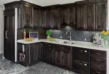 Modern Masculine Kitchen Design / dark stained cabinetry, stainless steel appliances, alcohol/wine bar with refrigeratior