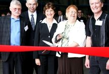 "Grand Opening /   VIP's, local politicians and staff gathered in celebration at the Grand Opening of the new office location. Guests were treated to plant tours via golf carts and enjoyed tasty canapés and cool refreshments. Upon departure, everyone was given a ""gold bar"" as an event souvenir."
