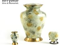 Cream and White Cremation Urns / Terrybear products are available at your local funeral home.