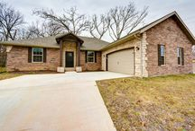 1075 S. 21st Ave, Ozark, Mo $159,900 / New Construction! ALL BRICK! ALL ELECTRIC HOME has so much to offer! Beautiful, Tall, Maple Cabinets, with Granite Countertops, Kitchen Island, Stainless Steel Appliances and Tile Floors. VERY OPEN FLOOR PLAN! Gorgeous Hardwood floors with vaulted ceilings in the Living Room. 4 BEDROOMS PLUS AN OFFICE with great French Doors! A very nice Master Suite with a Jetted tub and Separate Walk-in Shower! No neighbors behind you!