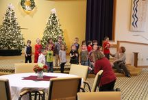 Annual Christmas Open House / The Michigan Masonic Charitable Foundation held their annual Christmas Open House today in the Doig Chapel. Residents and employees alike were entertained by the Luce School First Graders, who sang Christmas songs. Gifts of candy were given, and special Guest stars Santa and Mrs. Claus showed up!