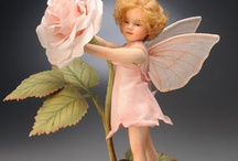 flores con muñecas