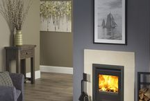 Umbrian Natural Stone Fireplace range / Umbrian stone mantels, shown with stoves mostly