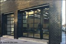 Museum and Gallery Glass Garage Doors / Museum and gallery locations with welded aluminum and glass garage doors installed. All doors manufactured by Arm-R-Lite