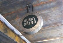 Husky Grind / The University of Washington's department of Housing and Food Services operates a host of coffee service venues across campus, ranging from coffee carts to storefront cafés. The time had come for the University to establish its own brand for these venues. Our team led the naming, identity development, signage, and graphics applications. The chosen name, Husky Grind, now represents not only the coffee service venues but will also roast coffee for the UW community.