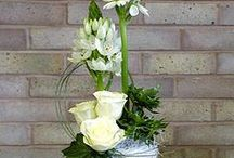 white flowers in a jug.