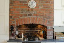 Baby, it's cold outside / Come in from the cold this winter and enjoy cooking in your toasty kitchen with these kitchen fireplace ideas.