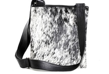 Cowhide Handbags & Totes / My favourite leather handbags with cowhide feature panels by Gorgeous Creatures.