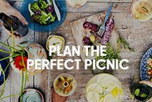 Perfect Picnics / A casual backyard picnic is a great way to host family and friends without breaking the bank. With a classic summer menu and a few picnic-friendly items - like a gingham tablecloth and a nice boxed wine - the only thing left to do is cross your fingers for nice weather.
