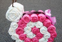 Diaper Designs / My creative outlet has been to make diaper cakes. Some are my design some are ideas I would love to try. / by Karine Ruiz