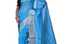 Others / This exquisite cotton saree from Andhra Pradesh has been woven using the Ikat technique which involves resist-dyeing the warp or the weft fibres, producing unique patterns adorning the fabric.This saree includes a matching blouse piece
