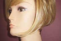 Heat Friendly Wigs / Synthetic wigs that are heat friendly, heat defiant, and Tru2Life. These synthetic wigs can be curled, straightened, and styled using low heat tools. Up to 350