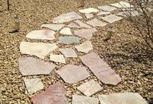 Natural Stone / Working with organic building materials in a landscape takes patience and craftsmanship from the builder. Each natural stone walkway, patio and retaining wall built by Groundworks is carefully crafted into beautiful pieces of art that add uniqueness to the homes they adorn.