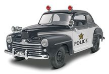 On The Scene / Revell models kits of service vehicles, including police squad cars and fire trucks.