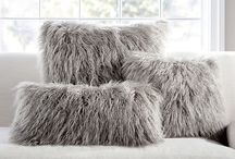 fur cushions and blankets