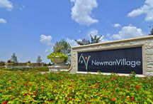 Newman Village European  / Extraordinary living. Thoughtfully designed. Newman Village is a new gated community located just off the North Dallas Tollway in Frisco. With its unique blend of architectural styles, European-inspired central plaza and a stunning grand boulevard as its signature street, Newman Village redefines living the good life. The central plaza, along with swimming, tennis and neighborhood parks and trails, invite you to live a dynamic life among friends and neighbors.