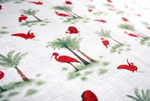 Ibis Designs - The Curator Collection / The Ibis Toile De Jouy is a #tropical interpretation of the traditional #toiledejouy pattern. The scarlet #Ibis is found in South America and the Caribbean.  Its bright plumage in an audacious red contrasted with the delicately drawn palm trees will create a hint of #flamboyance to any scheme. #interiors #interiordesign #inspiration #fabric #birds #style #home