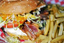 Giant Burgers and Sammys! / We love sandwhiches piled real high with allll the fixins' / by Duke's